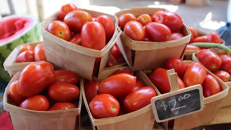 Roma tomatoes at farmers market photo