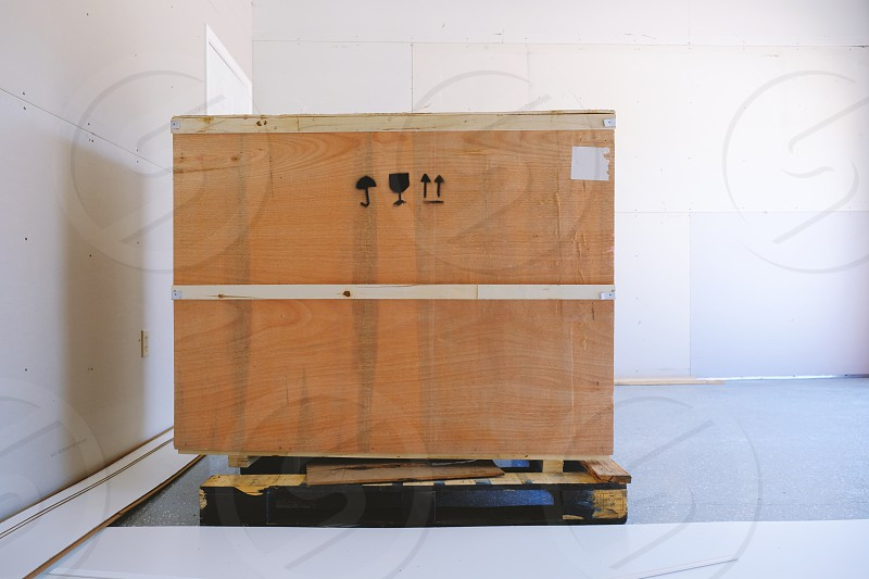 Wood cargo shipping box inside of a room. photo