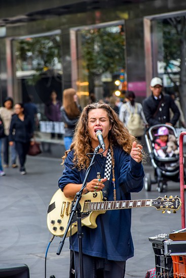 vocalist singing on road during daytime photo
