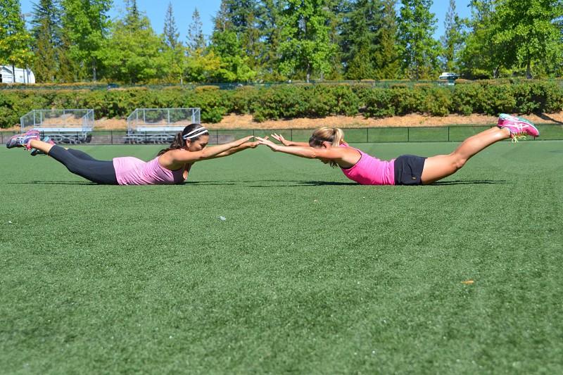 Superman stretching athletes athletics training woman  photo