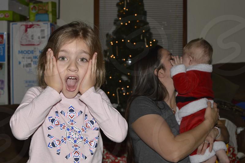 Mommy Baby Santa Daughter Son Christmas Tree Lights Kiss  photo