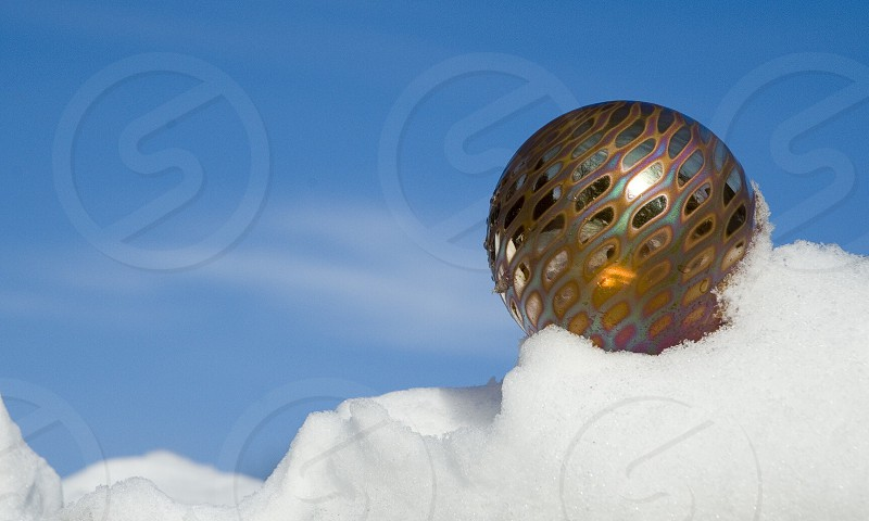 brown and yellow ball on snow field photo