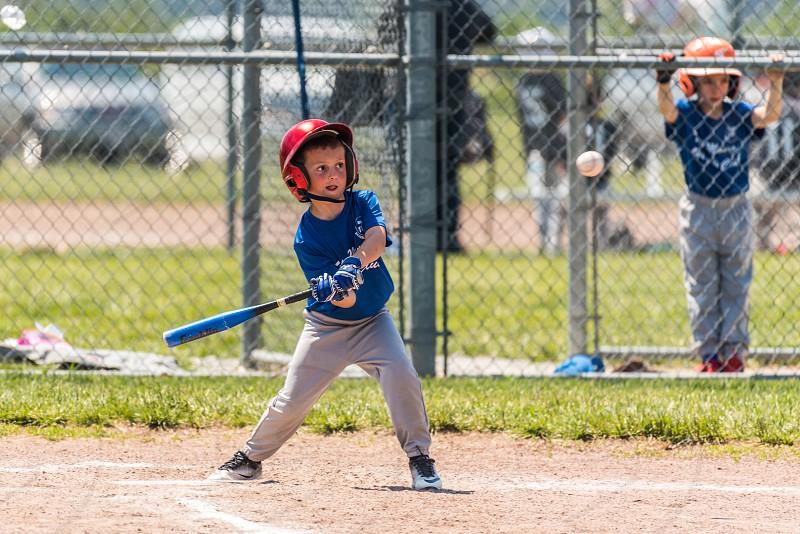 Little boy batting in a baseball game. photo