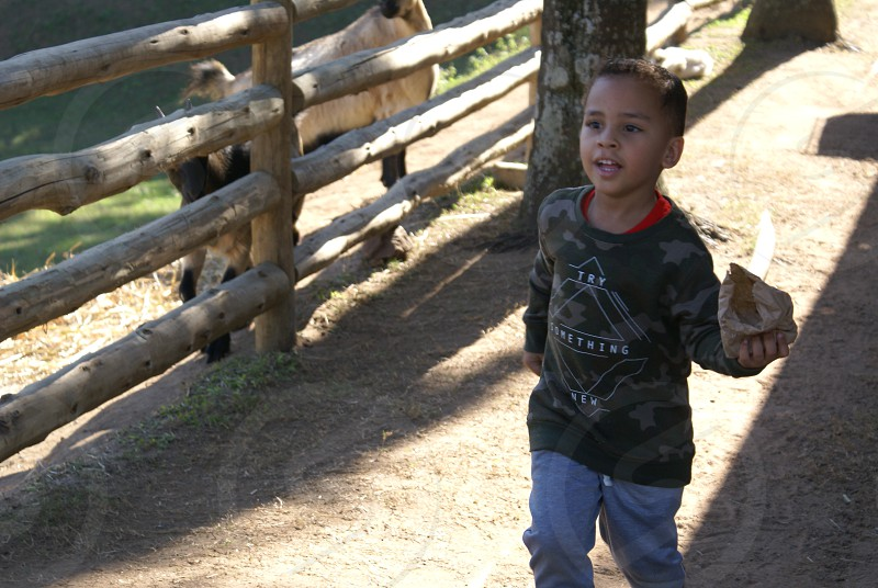 boy running farm happy photo