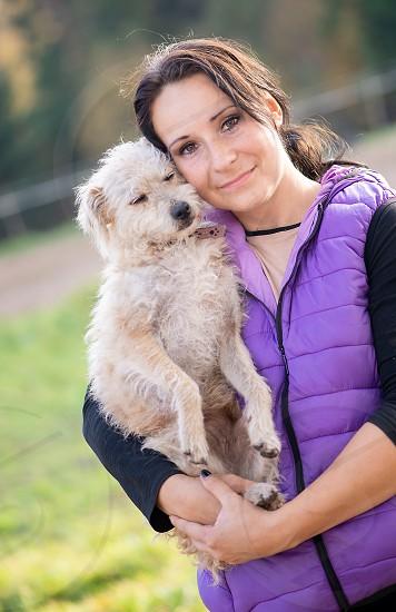 Young woman hugging dog photo