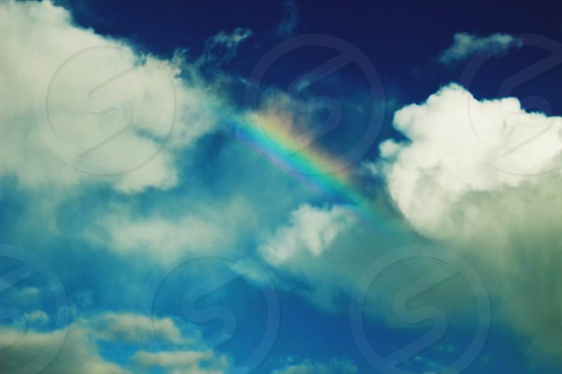 rainbow with cloudy sky photo