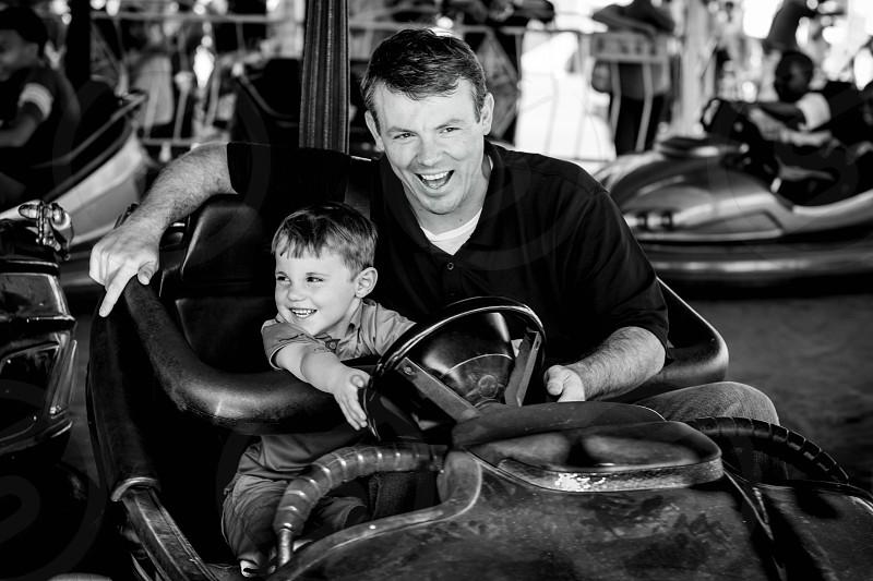 Bumper cars dad and son fair fall amusement park photo