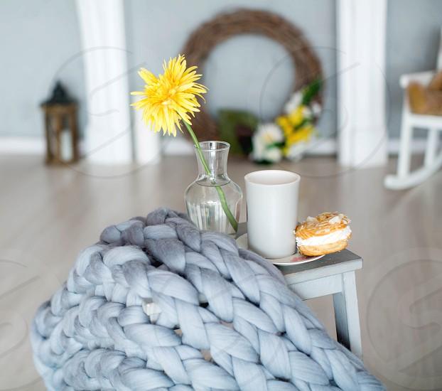 Beautiful blanket flowers coffee and bun photo