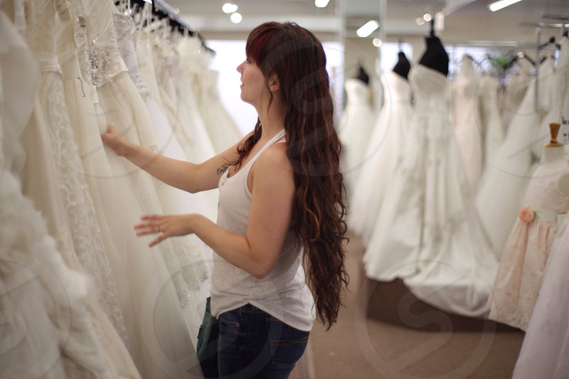 lady looking at wedding dresses photo
