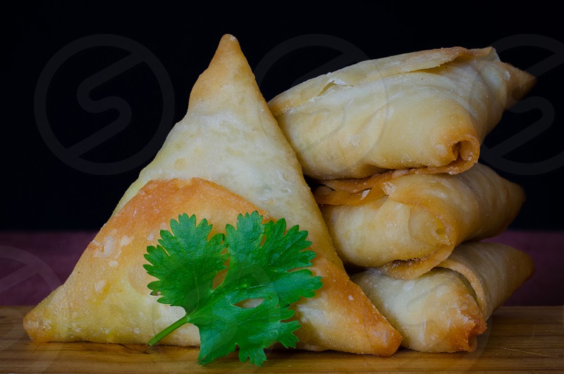 Samoosas also sometimes referred to as a somosa are an ever popular Indian delicacy in Durban South Africa. Durban has the largest Indian polulation of any Western city in the world. photo