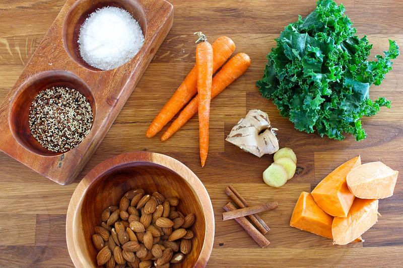 Healthy ingredients. Kale carrot almonds cinnamon ginger sweet potato quinoa coconut. photo