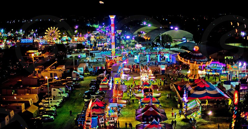 amusement park rides and store with lights photo
