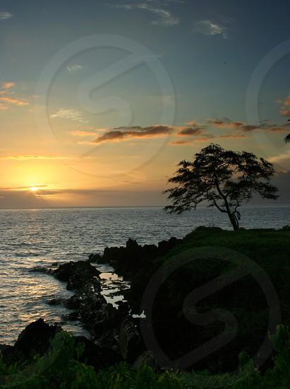 Maui Hawaii sunset on a rocky beach overlooking the pacific ocean photo