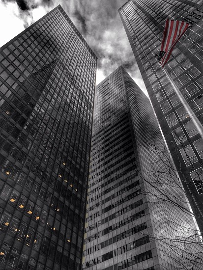 tall building with a dark cloudy sky  photo