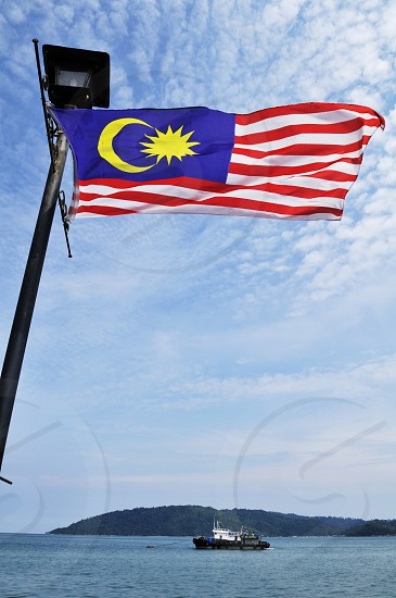 Flag of Malaysia against scenic view photo