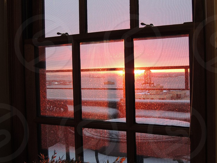 view of a sunset from inside a building photo