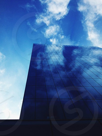 Building reflecting clouds photo