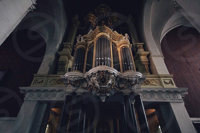 A photo in a church in The Netherlands. This is the Organ of the church photo
