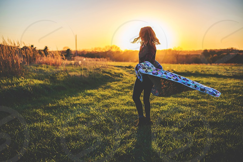 woman spinning in the sunset photo
