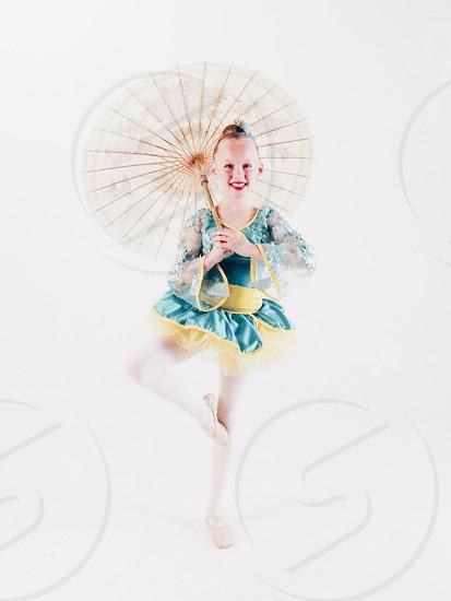 Dancer umbrella Asian theme white hi-key girl.  photo