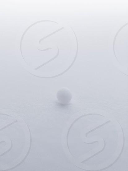 tiny small round circle sphere nonpereil close up sugar white minimal snow cold alone lonely photo