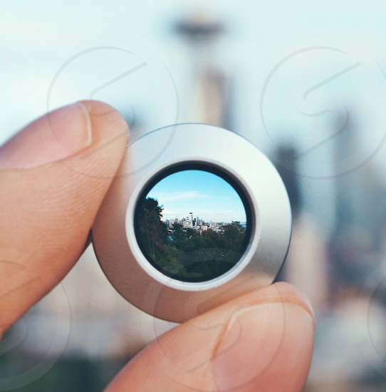 reflection of green trees on stainless steel button photo