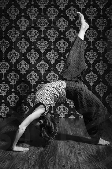 Yoga posing at studio. Black and white photo