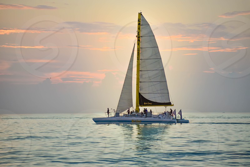 Clearwater Beach Florida. January 25 2019 . People enjoying of sailboat on colorful sunset background in Gulf Coast Beaches (1) photo