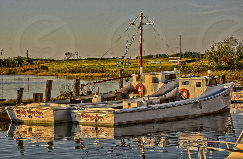 """""""Hard working ladies"""" Two work boats moored at Missic Point in Poquoson Virginia USA  photo"""