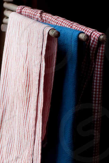 red and white striped textile photo