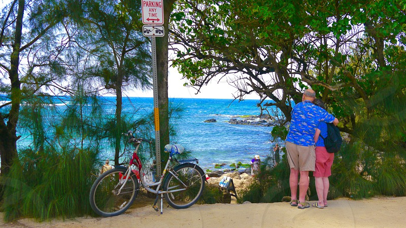 Love vacation hawaii north shore Valentine's Day 808 beach ocean couple people hug cuddling hugging bicycle photo