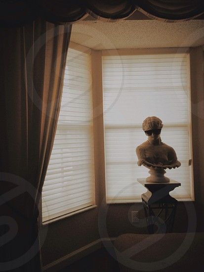 Sculpture living room Rome Greek mythology sunshades shades on sculpture Athena dim lighting curtains blinds art photo