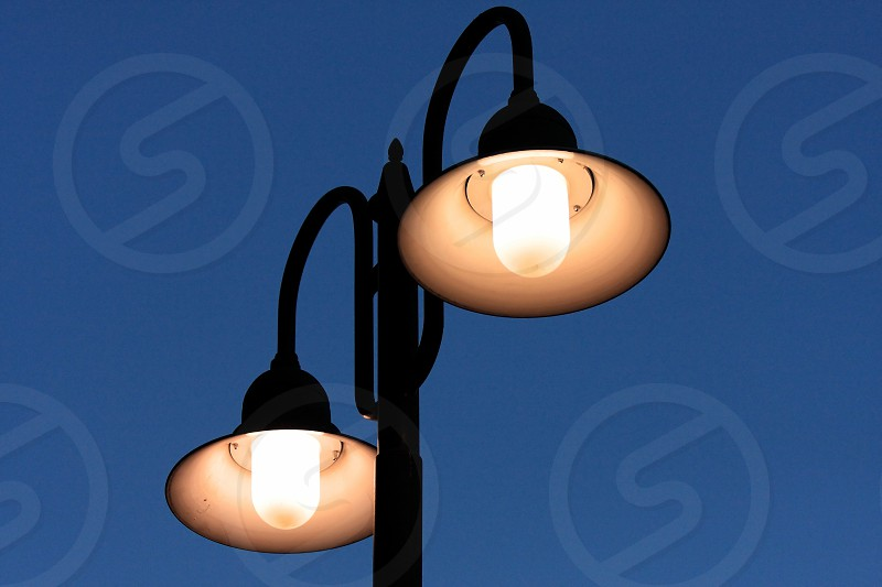 2 brown and black street lights photo