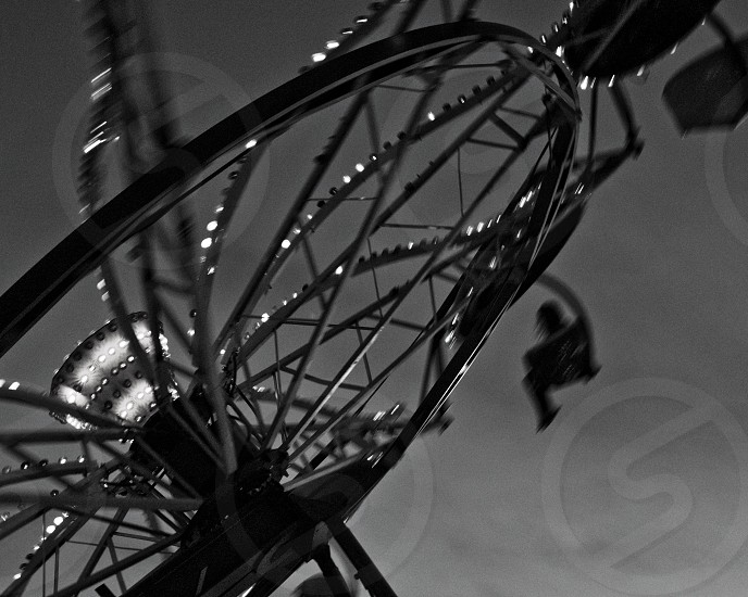 Photo of a lone rider on a carnival ride photo