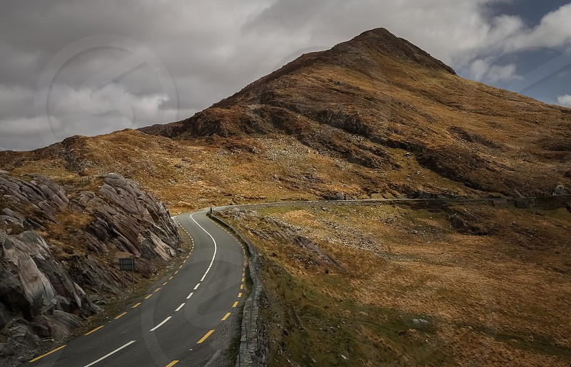 highway road mountain cloudy sky photo photo