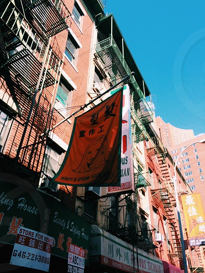 brown building with orange kanji characters flag photo