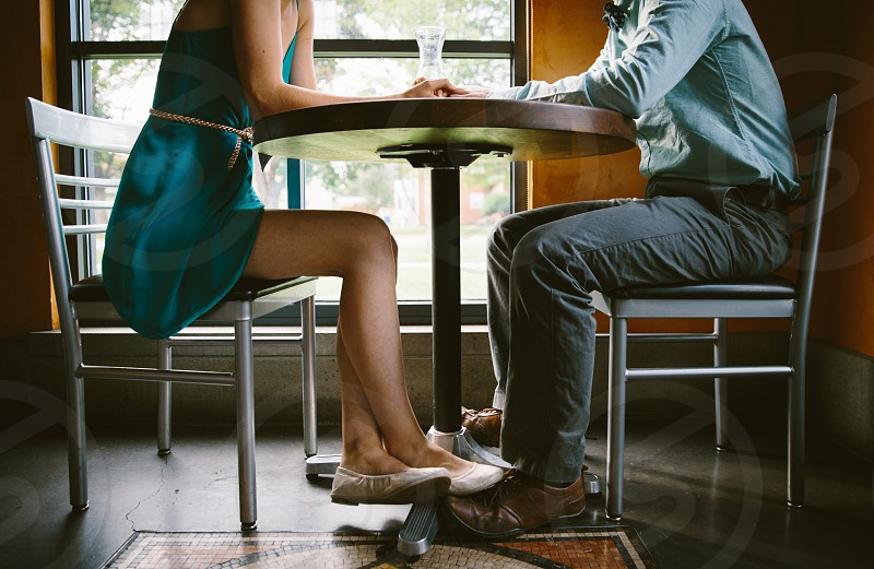 woman and man sitting at table photo