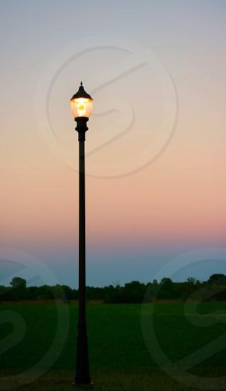 Simple lamp post at dusk photo