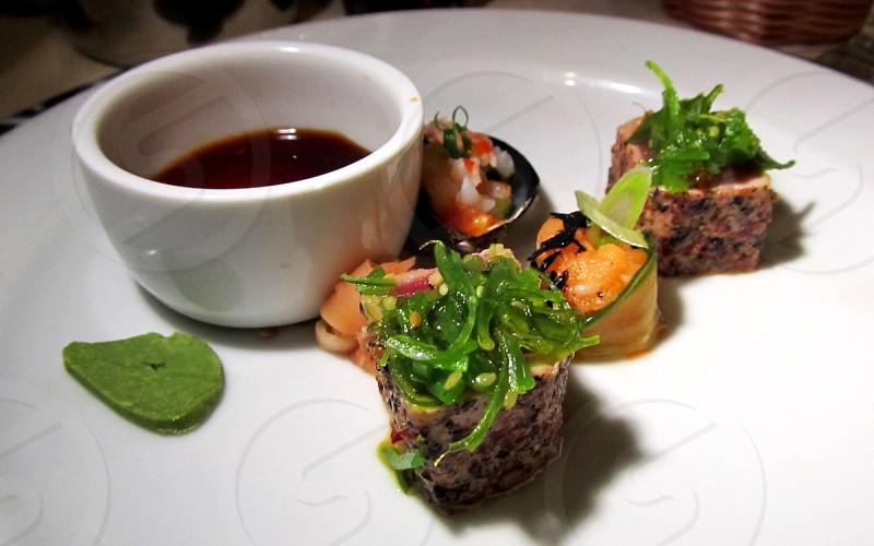 Sushi plate with tuna tartar and seaweed photo