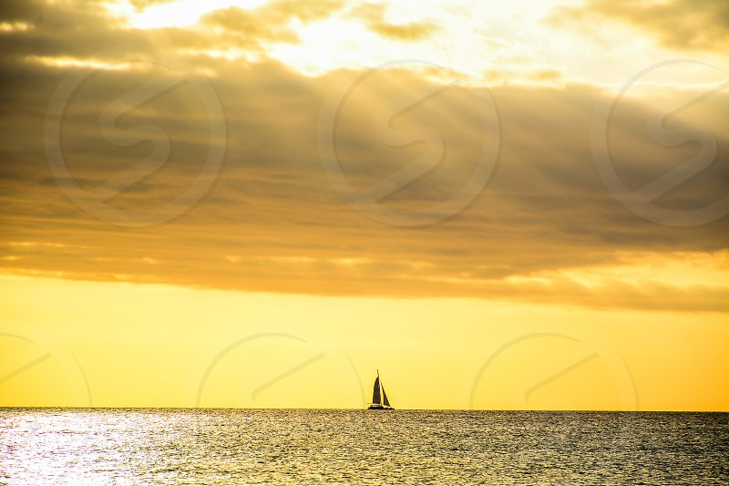 A boat in the middle of the Caribbean sea in Playa Dominicus with sunrays photo