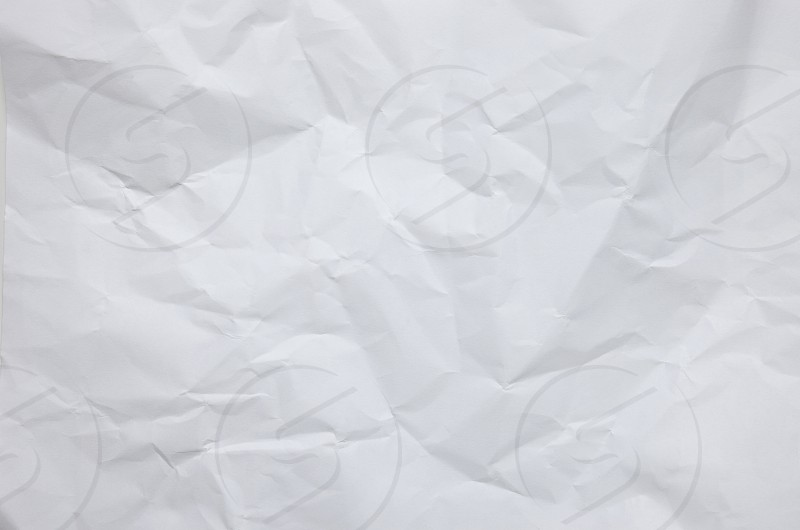 Abstract white crumpled paper textured background wrinkle crumpling style background wallpaper photo