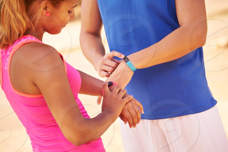fit watch running sport jogging woman girl man activity athletes beat body bracelet counter couple energy equipment exercise exercising fitband fitness fitwatch happy health healthy heart heart beat hispanic jogger looking outdoors people persons rate run runner smartwatch sports sporty steps talking technology time tracker training wearable working out workout wrist young photo