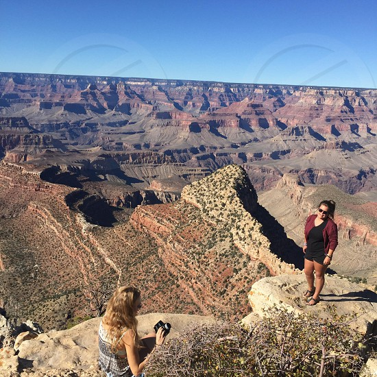 photography of mountain canyon with two girls photo