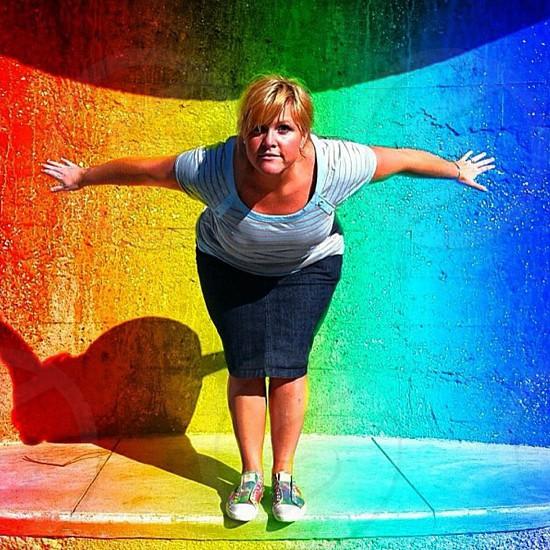 A woman on a rainbow wall  photo