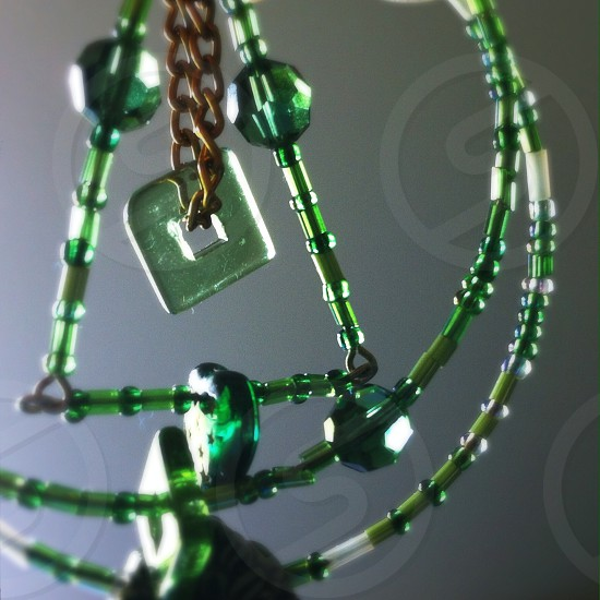 Green beads jewelry circles square heart triangle rings seed beads glass. photo
