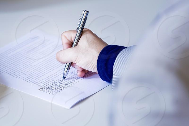 Businessman signing an NDA photo