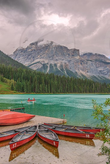 Boating on Emerald lake during the rain. Michael peak is in the background. Yoho National Park. British Columbia. Canada photo
