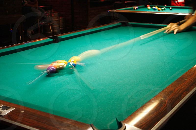 person playing billiards photo