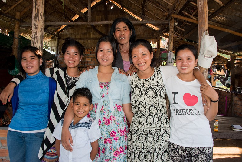 Family of sisters and sisters-in-law with mother and son outside of Siem Reap Cambodia.   photo