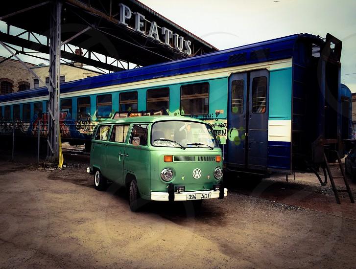 Outdoor day horizontal landscape colour filter van VW camper automobile transport train carriage soviet Baltic green blue Tallinn Estonia Europe European travel vintage photo